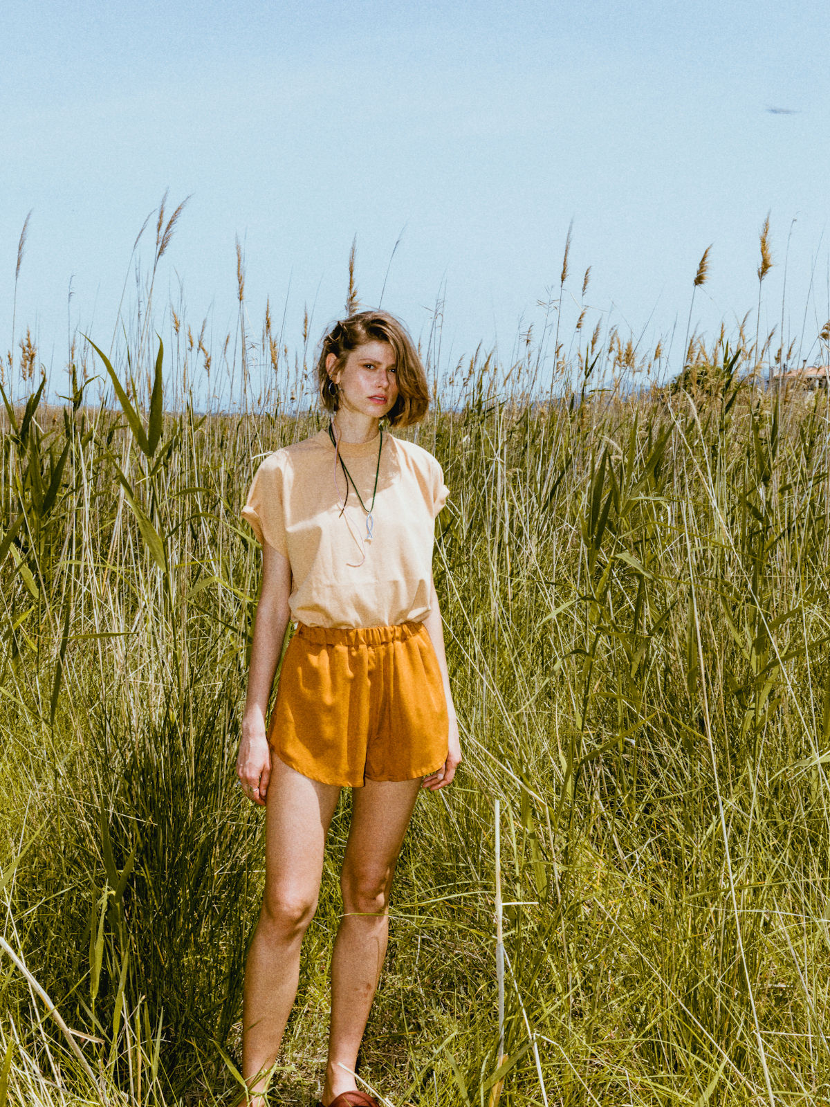 Beige t-shirt with orange shorts
